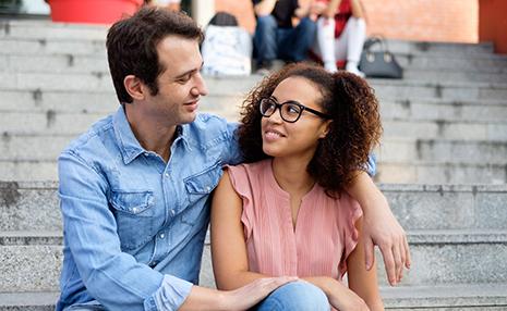 black woman white man hugging